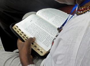 Sudanese man reading the Bible smaller