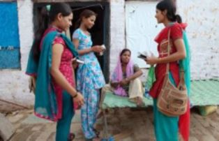Women missionaries helping out smaller