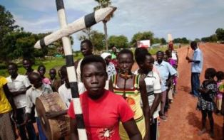 Young Sudanese Christians with the cross smaller