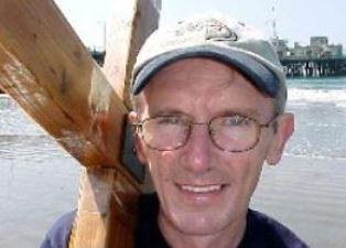 John Edwards carrying cross smaller