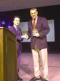 Johnny Kim presentation of the plaque