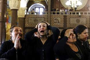 Coptic women after an attack smaller