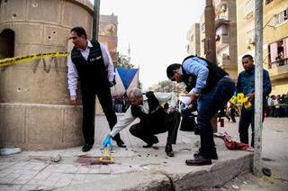 mi Egyptian police officers inspecting the site of the attack on Friday Dec. 29