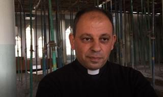 mi Father Thabet in his church that is being rebuilt.12 12 2017