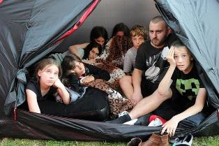 Homeless family in a tent smaller