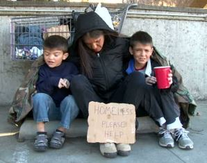 Homeless family living on the streets smaller