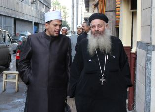 Iman and Coptic priest together smaller
