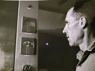 Stan Houghton checks transmitter readings at a station in Ecuador smaller