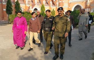 mi Bishop of Multan Leo Paul left shows security personnel around his cathedral three days before Christmas.01 12 2018