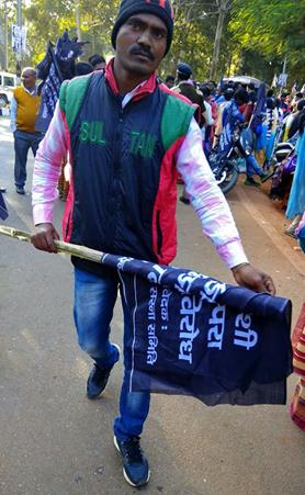 mi Tribal activist carrying black flag the day before Christmas in Jharkhand state India. Morning Star News01 19 2018