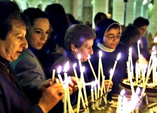 palestinian christians lighting candels smaller