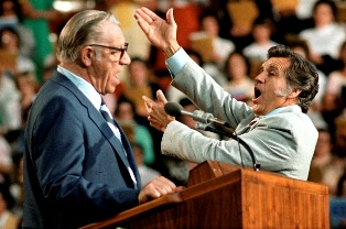 Cliff Barrows conducting his old friend George Beverly Shea smaller