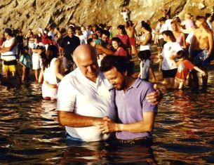 Glen Megill being baptized by Chuck Smith smaller