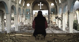 Man in church in Allepo