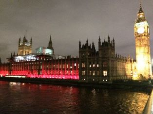 main British Parliament lit up in red