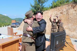 mi North Korean leader Kim Jong Un with a military scientist 02.03.2018