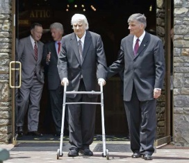 Billy Graham and walker with Franklin Graham smaller