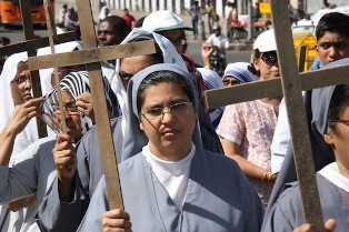 Indian Christians carry the cross