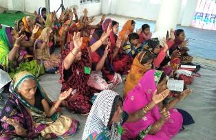 Indian women worshipping